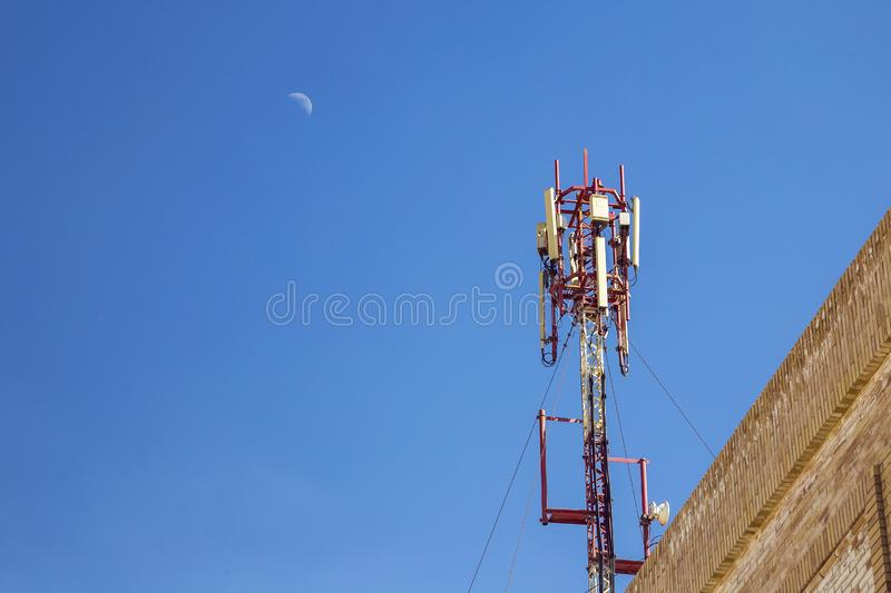 Cellular antenna. Communication on a building roof top stock image