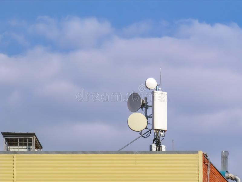 Cellular antenna on the roof stock images