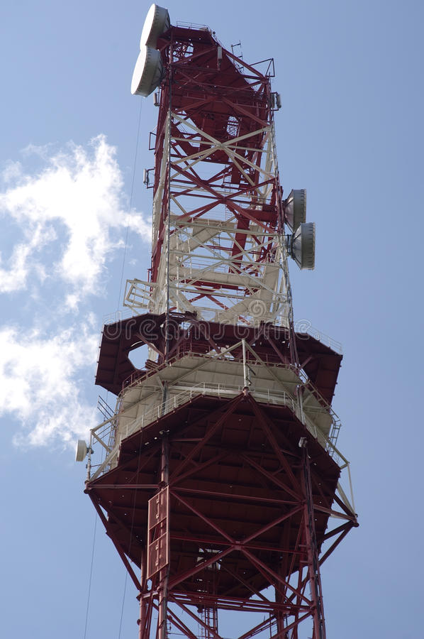 Cellular antennas. Tower with antennas of cellular communication on the background blue sky stock photo