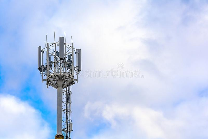 Cellular communication tower on a background of cloudy sky. Soft focus. Concept: communication and broadcasting, business, mobile. Communications, digital data royalty free stock photo