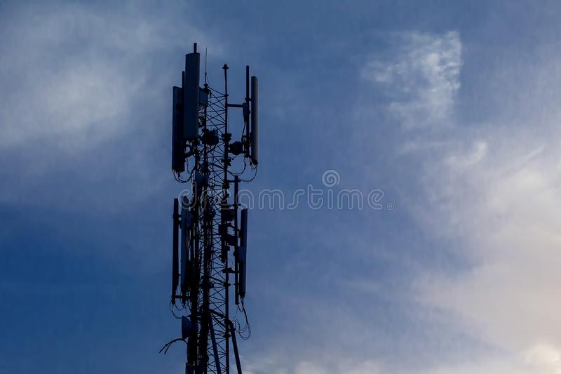 Cellular telecom pole high tower 3G 4G 5G , with blue sky background. Cellular telecom pole high tower 3G 4G 5G , with blue sky and clouds background stock images