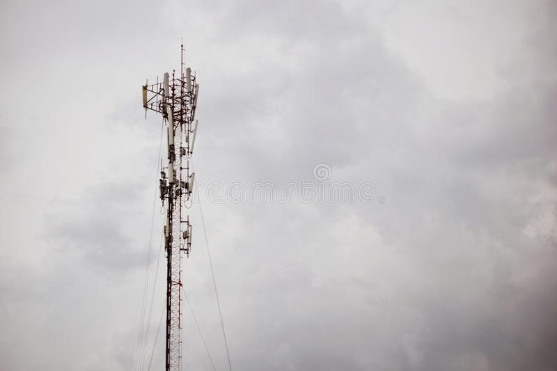 The cellular telecommunication antennas on the roof of the building. The cellular telecommunication antennas pole on the roof of the building royalty free stock photography