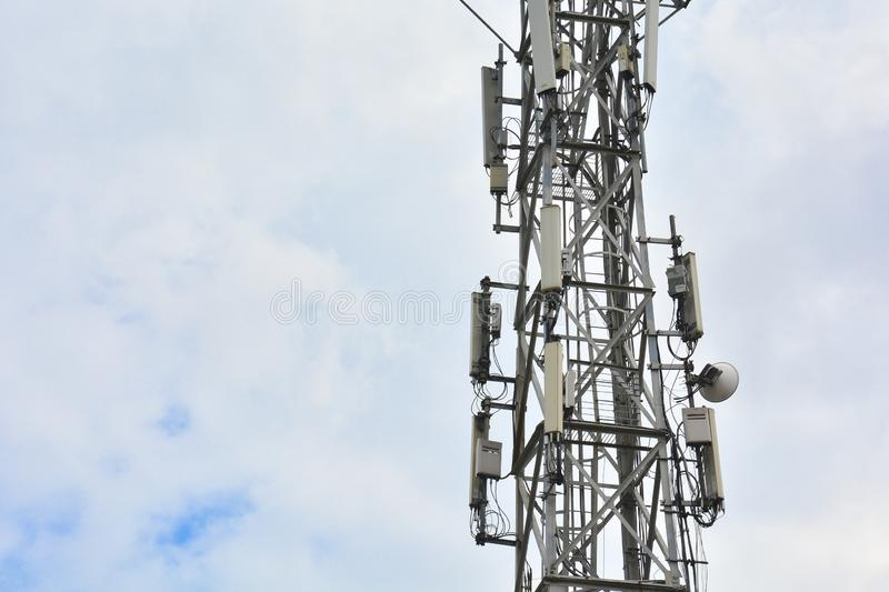 Cellular tower with antennas for connecting people by means of telephony and internet. Telecommunication equipment on tower.Close- stock image