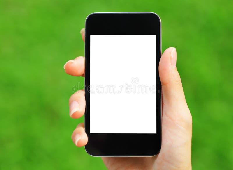 Cellulare della tenuta della mano della donna immagine stock libera da diritti