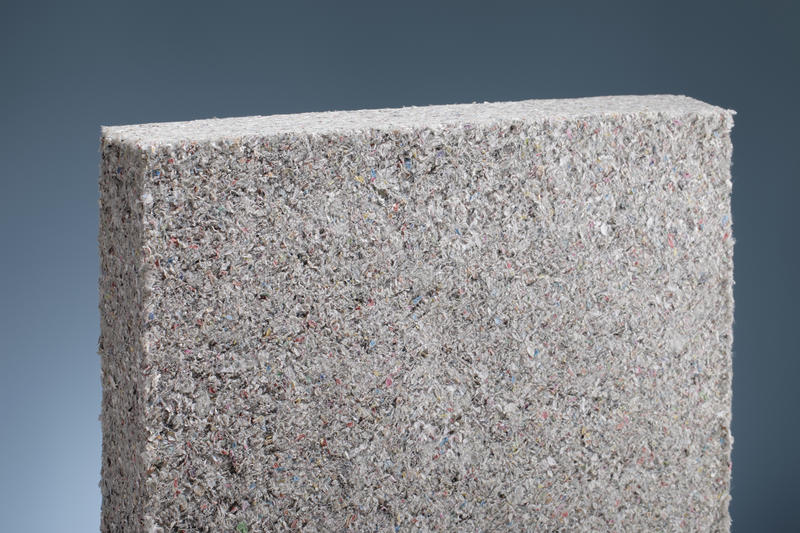 Cellulose insulation. Batt panel, made of recycled newspapers, used as building thermal insulation stock photo