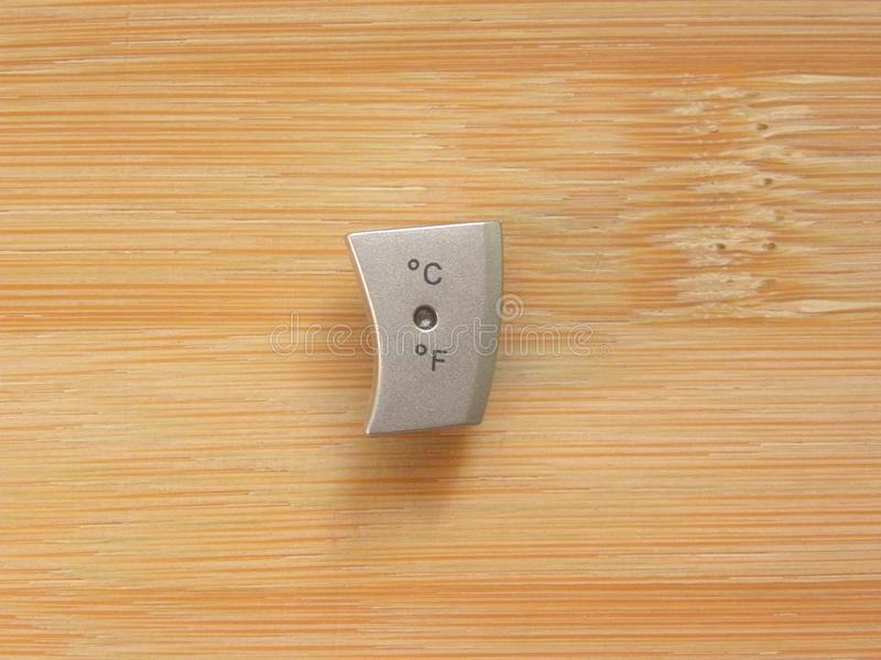 Celsius and Fahrenheit button. Degree Celsius and Fahrenheit button isolated kept on wooden table royalty free stock photos
