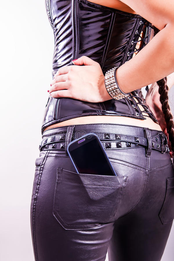 Celtelefoon in achterzak royalty-vrije stock afbeelding