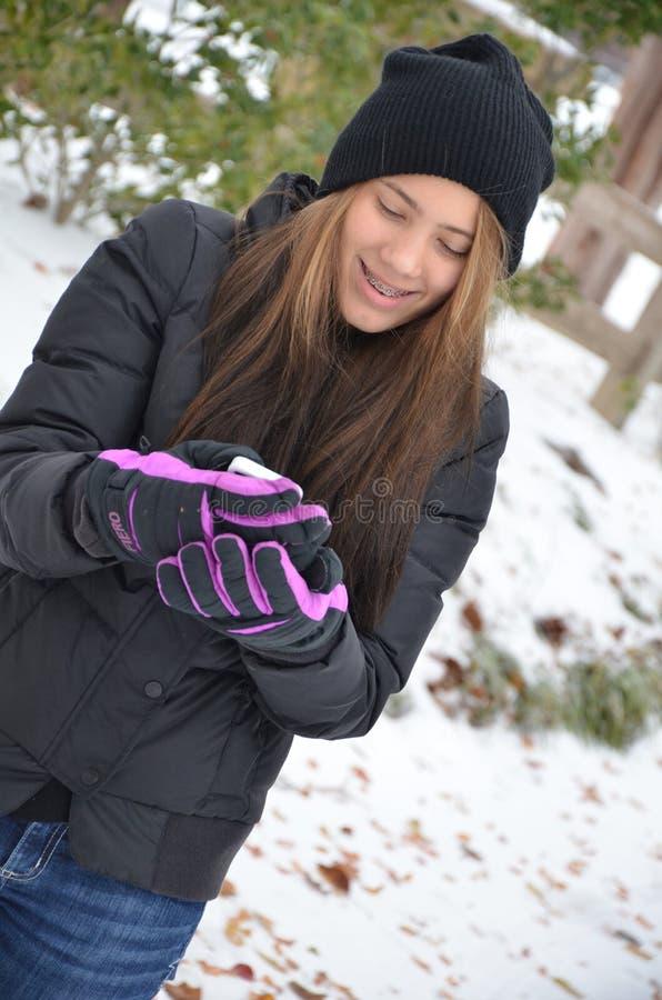 Celtelefoon en handschoenen stock fotografie