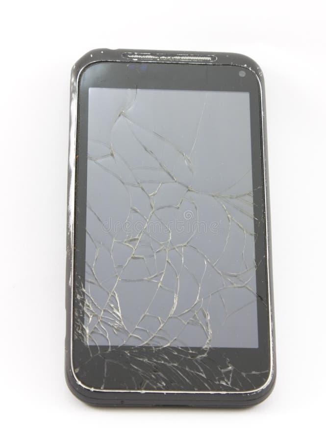 Celtelefoon met het gebroken scherm stock fotografie