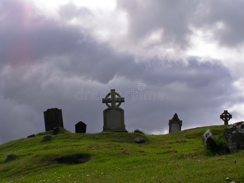 Celtic cementary. Celtic cemetery, crosses on a heavy clouds background, Halloween thrilling evening stock image