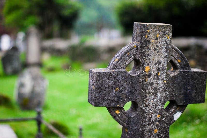 Celtic cross in a cementery at Glendalough Ireland stock photo
