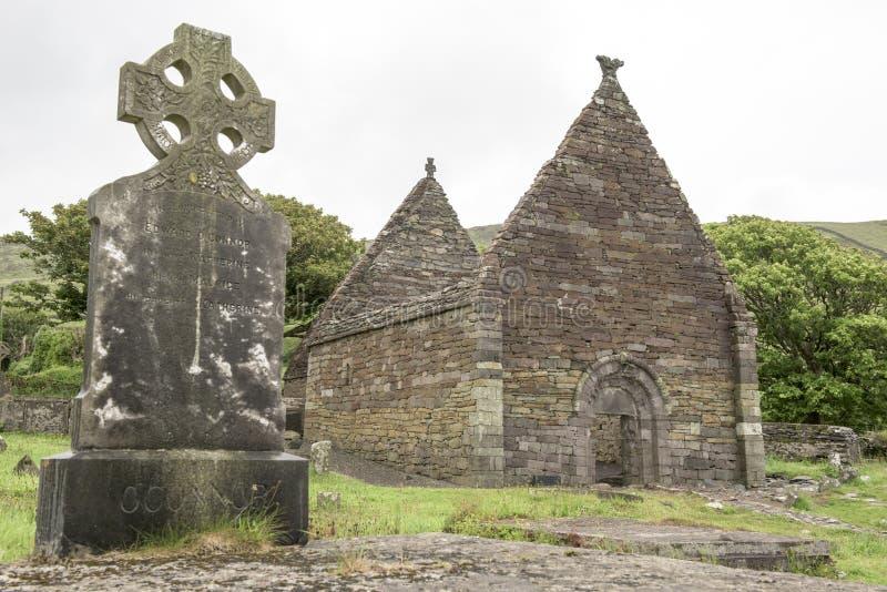 Celtic cross and ruin of church, Ireland. Celtic cross and ruin of ancient Kilmalkedar Church royalty free stock image