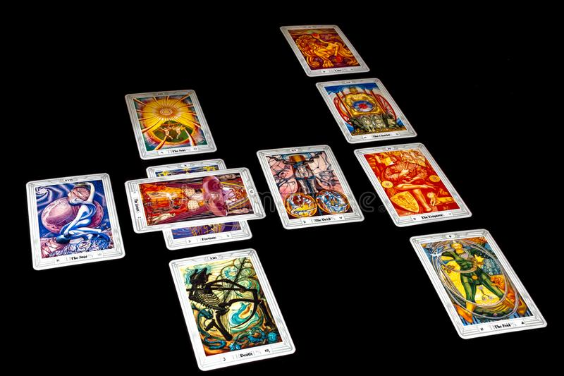 Celtic Cross Spread. A Celtic Cross tarot card spread using the Crowley/Harris Thoth deck stock image