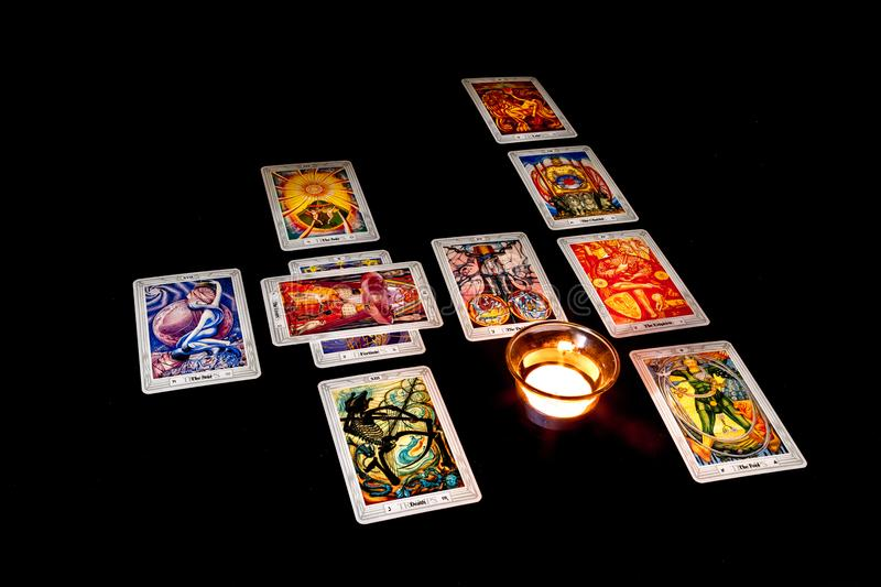 Celtic Cross Tarot Spread. A Celtic Cross tarot card spread using the Crowley/Harris Thoth deck stock images