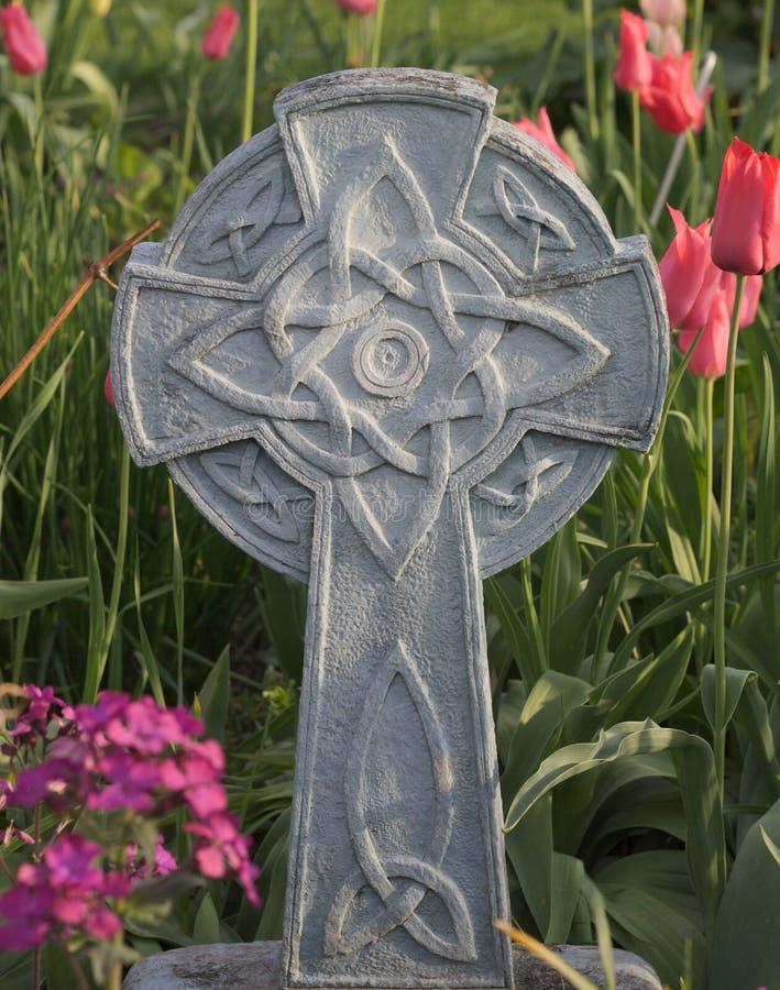Celtic Cross among Tulips stock image