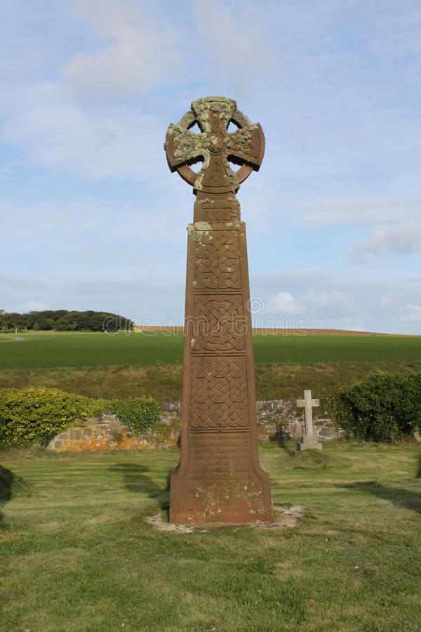 Celtic crosses, Saint Brides Churchyard, Pembrokeshire coast. Celtic crosses in churchyard , Saint Brides Church, view of Pembrokeshire coastline royalty free stock photography