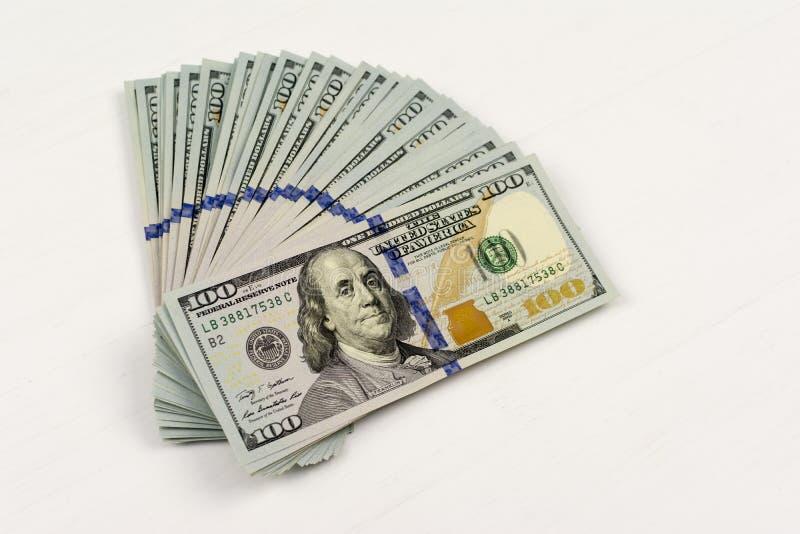 Cem contas de dólar no branco imagens de stock royalty free