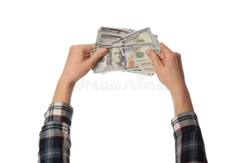 Cem dinheiros das notas de dólar à disposição isolados no fundo branco Renda, lucro e economias fotografia de stock royalty free