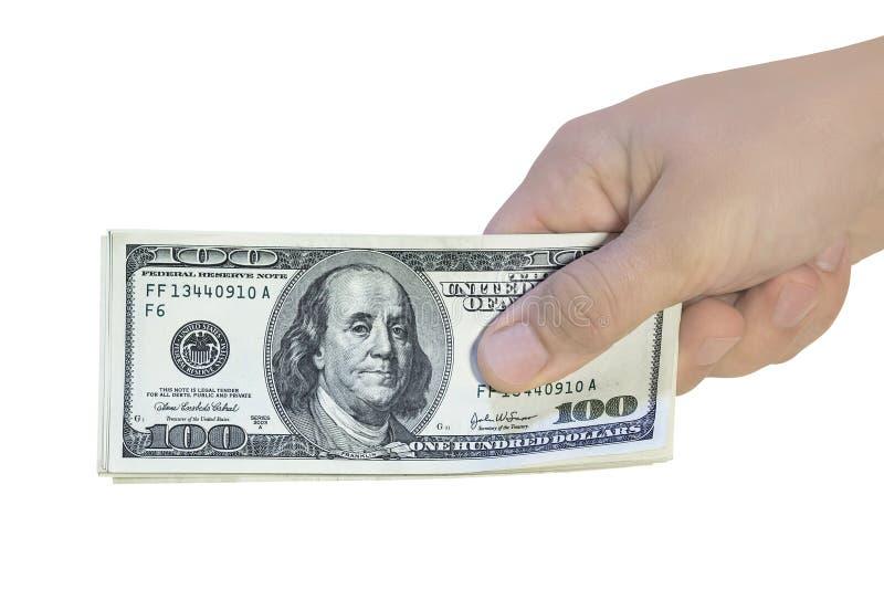 Cem notas de dólar à disposição Dando o dinheiro americano do dinheiro, isolado no branco imagens de stock royalty free