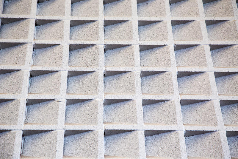 Cement accoustic wall. Cement baffles on a wall improving accoustics. Interesting background pattern or texture stock images
