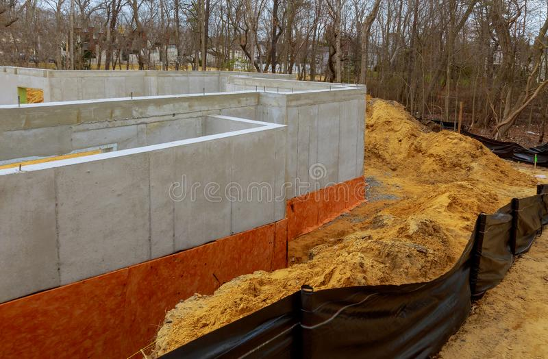 The cement basement foundation of a new housing development. Basement cement foundation of a new housing development house building activity underground concrete royalty free stock photo