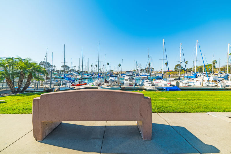 Cement bench in Oceanside harbor. California royalty free stock image