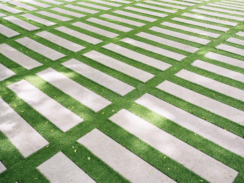 Cement block on green glass Landscape design outdoor garden stock photo
