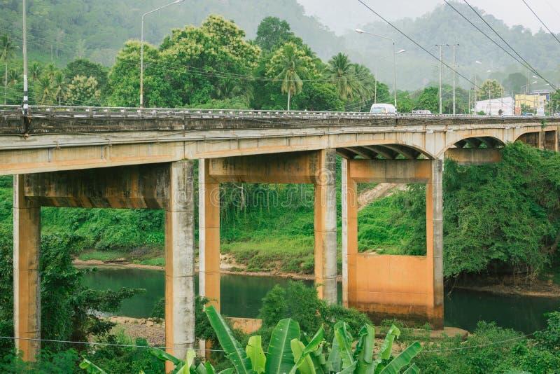 Cement bridge across the mountains landscape royalty free stock images
