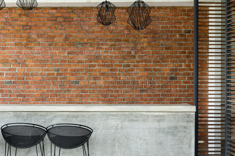 Cement counter nightclub with seat bar stool and brick wall. Background stock photos