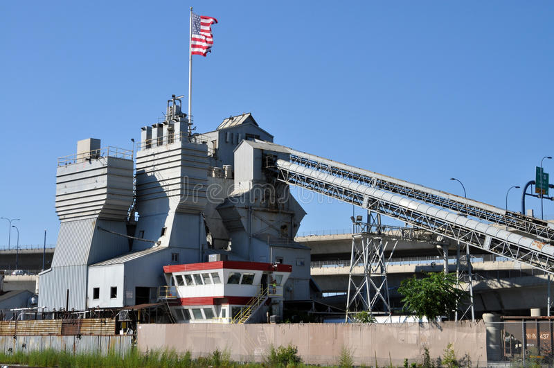 Cement factory with American flag. Big cement factory with American flag stock images
