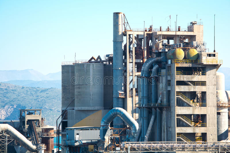 Cement factory. Detail of a cement factory under the blue sky stock images