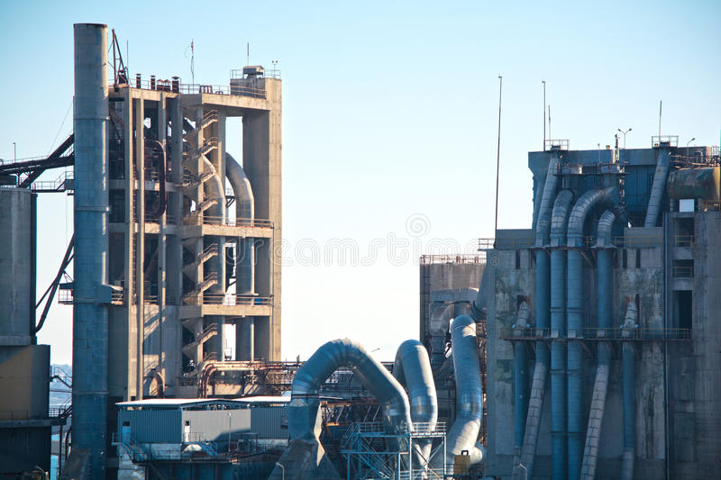 Cement factory. Detail of a cement factory under the blue sky royalty free stock images