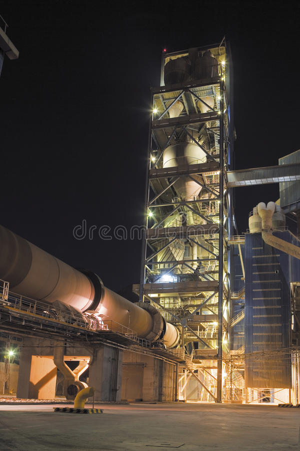 Cement factory detail view. Cement kiln,silos and conveyor line stock photography
