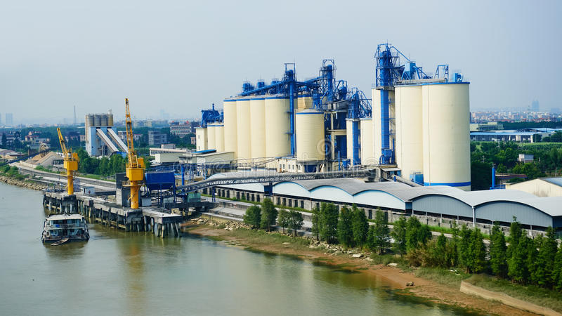 Cement factory. Modern cement factory at river side stock photography