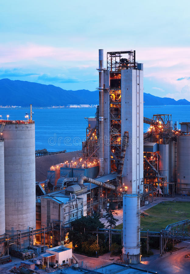 Cement factory at night stock image