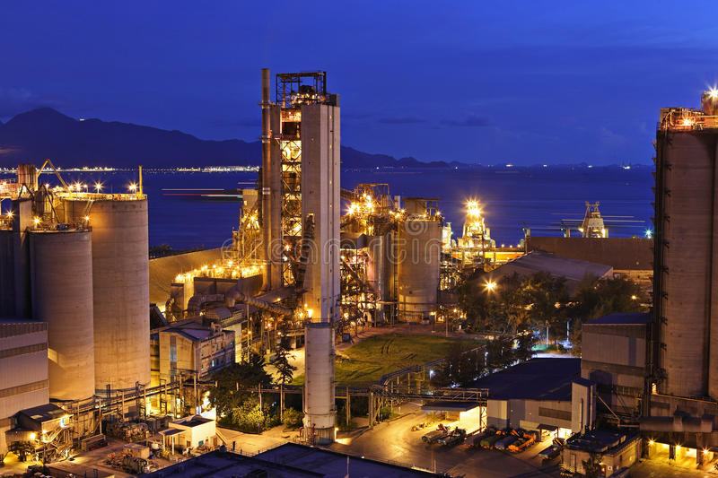 Cement factory at night stock photography
