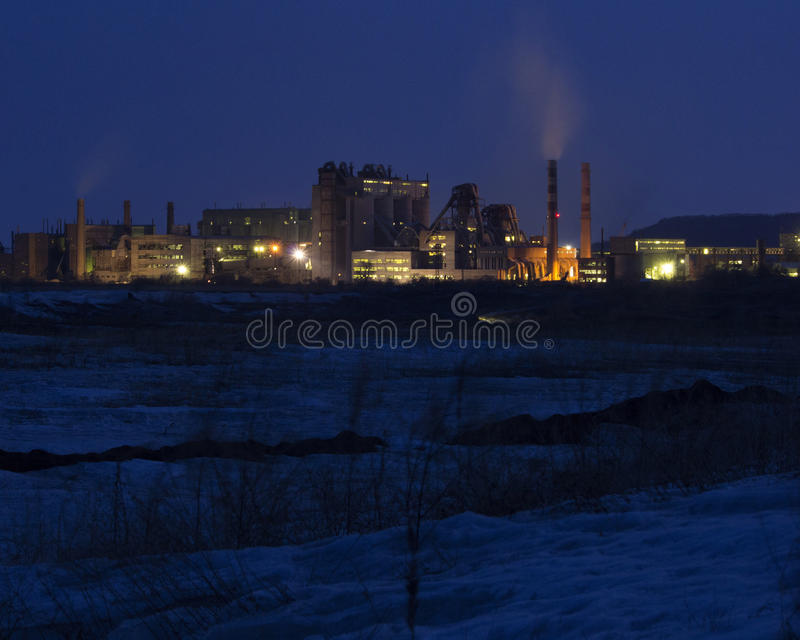 Cement factory at night. Heavy industry royalty free stock images