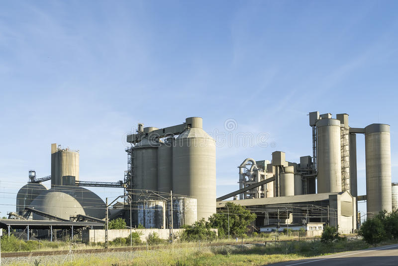 Cement factory. Overview of a cement factory with various installations and concrete silos stock photo