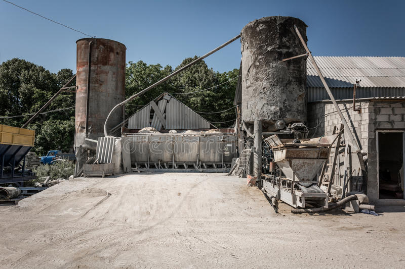 Cement factory. Part of a small cement factory stock photography