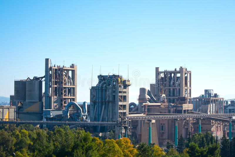 Cement factory. View of a cement factory under the blue sky royalty free stock image