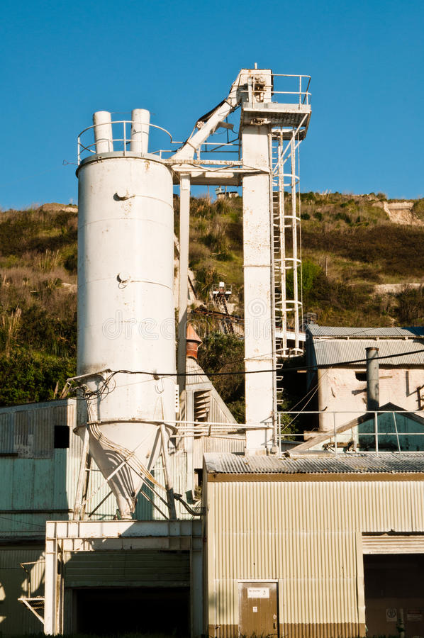 Cement manufacturing plant. A fragment image of cement manufacturing plant with feeder, gantry and main building royalty free stock images