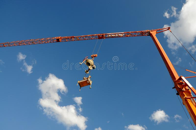 Cement mixer and circular saw, burglar proof. Theft protection, hanging cement mixer and circular saw at construction site royalty free stock photo