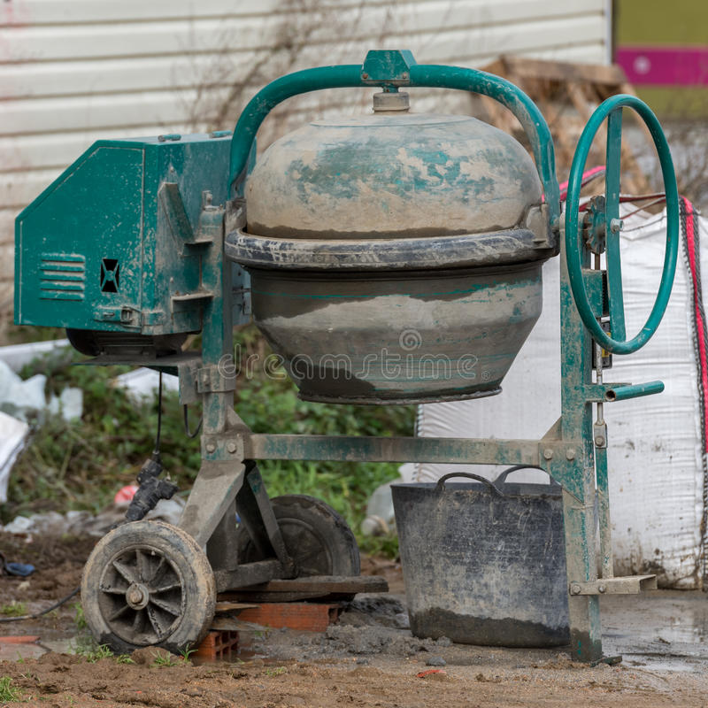 Cement mixer at a construction site close-up stock images