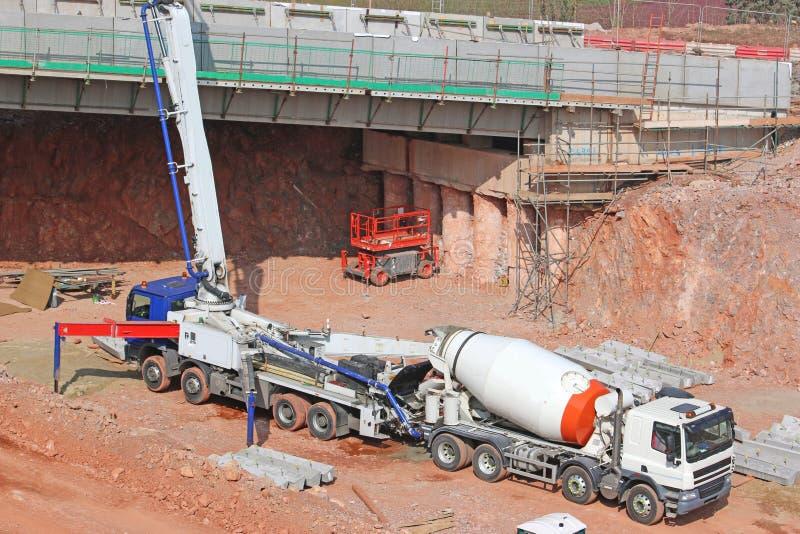 Cement mixer on a construction site. Concrete mixer pouring concrete for a new bridge stock photography