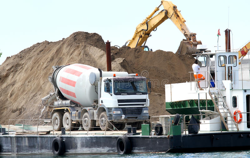 cement mixer in the construction site by the sea for the construction stock photos