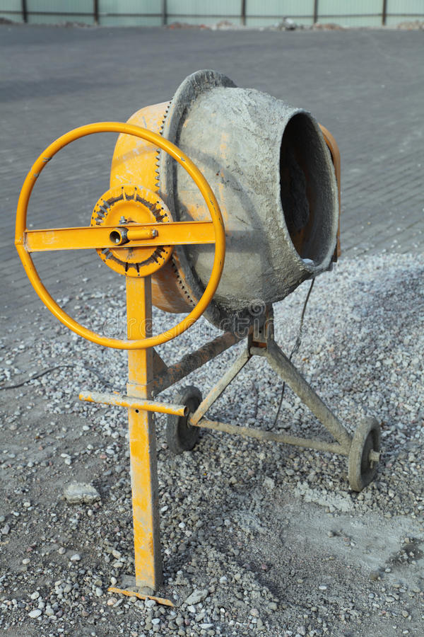 Cement mixer. A small portable concrete mixer at the construction site royalty free stock photo