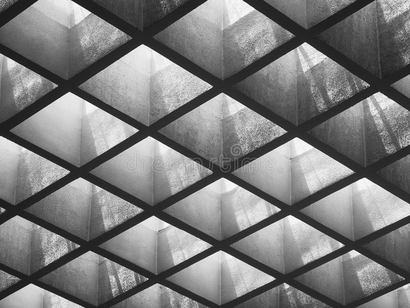 Cement panel ceiling pattern Lighting void Architecture details royalty free stock images