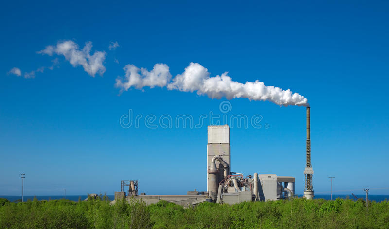 Cement plant. A photography of a cement plant under a blue sky royalty free stock photos