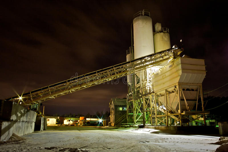 Cement Plant at Night. An industrial cement mixing plant at night stock photos