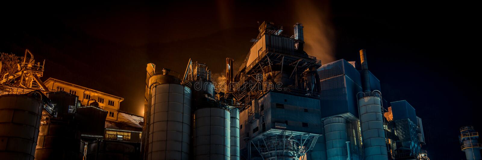 Cement plant in the night royalty free stock photography